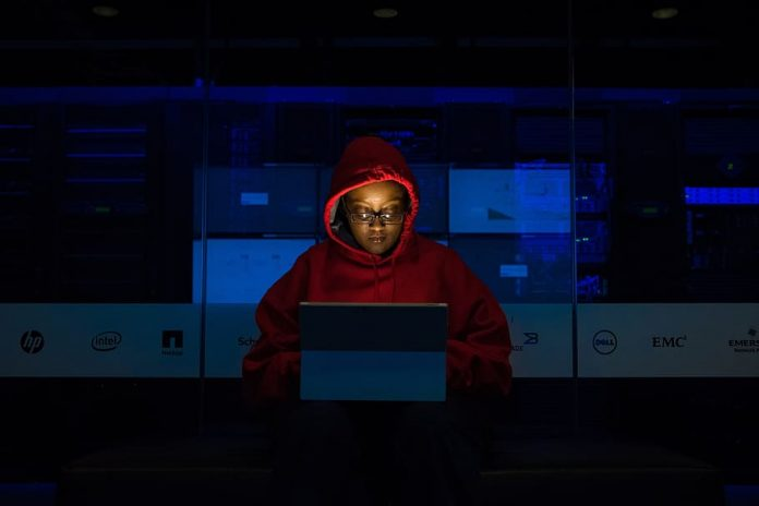 woman-coding-dark-night