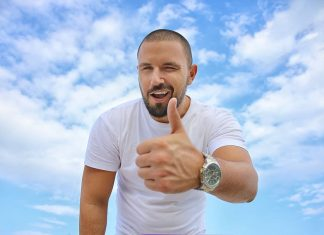 man-thumbs-up-wink-smile-happy-blue-sky